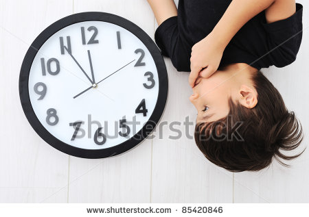 stock-photo-child-and-clock-time-concept-85420846